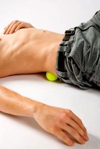 Tennis ball for massaging glutes