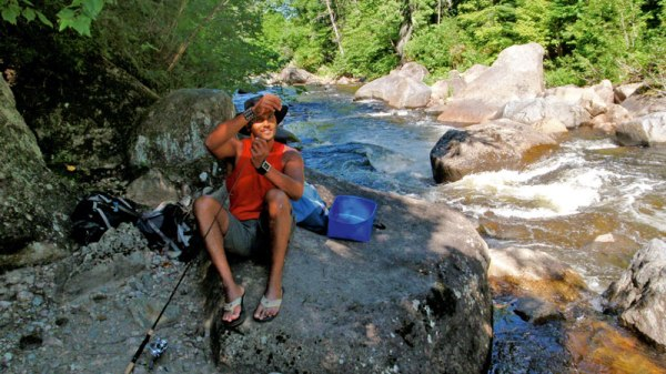 Fishing for trout close to Hautes Gorges National Park in Quebec.